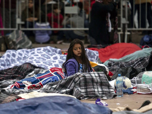 Number of caravan migrants allowed into United States rises to 158